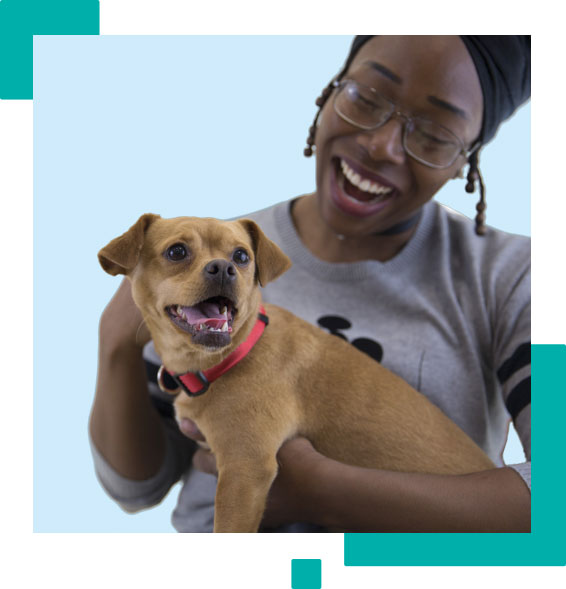 Domestic Violence Survivor Holds a Dog with a Blue Background